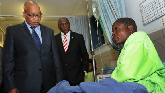 Miner Mfaseni Yekwayo, at a hospital near Rustenburg on August 18, relates to South African President Jacob Zuma, left, the events leading to the miners' clash with police.