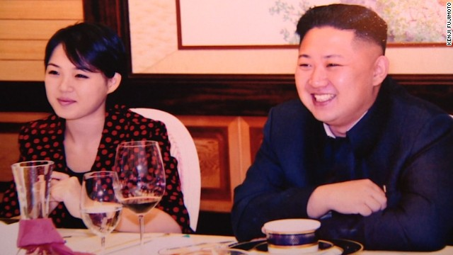 North Korean leader Kim Jong Un and his wife, Ri Sol-ju, are pictured at a party in July.
