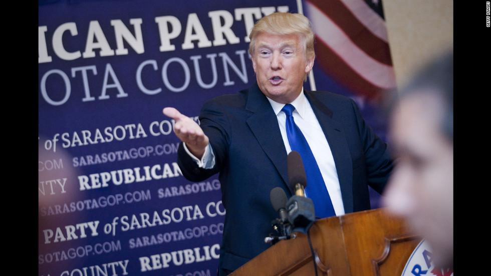 Donald Trump, who accepted the Statesman of the Year Award from the Sarasota County Republican Party, answers questions in Sarasota, Florida.