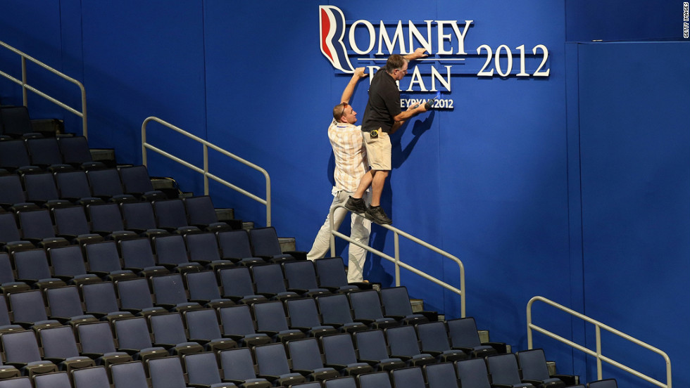 Convention staff hang a Romney-Ryan sign at the Tampa Bay Times Forum on Sunday, August 26, in preparation for the Republican National Convention.