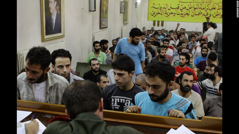 Men arrested for their involvement in anti-regime protests wait to be released in Damascus on Monday. The official Syrian news agency reported that authorities released 378 people detained for their participation in street protests, adding that those freed were never involved in acts of violence.