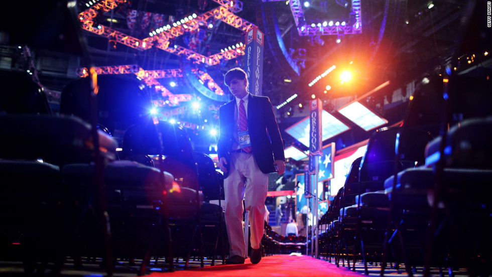 A participant walks the convention floor before the start of proceedings Tuesday. Organizers pushed events back a day because of concerns about Isaac.