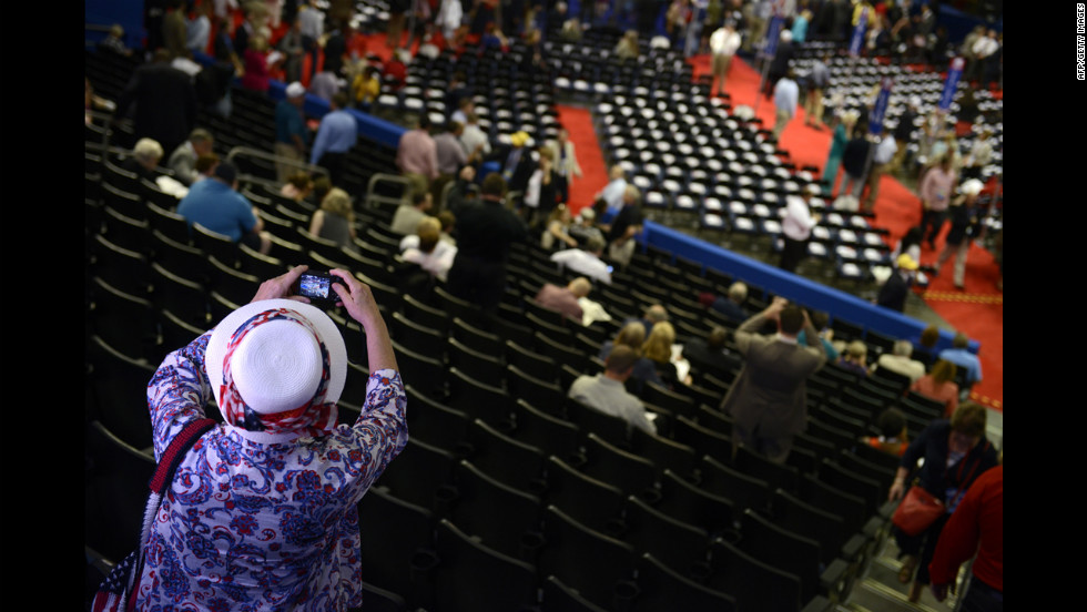 A delegate takes a picture of the floor at the Tampa Bay Times Forum.
