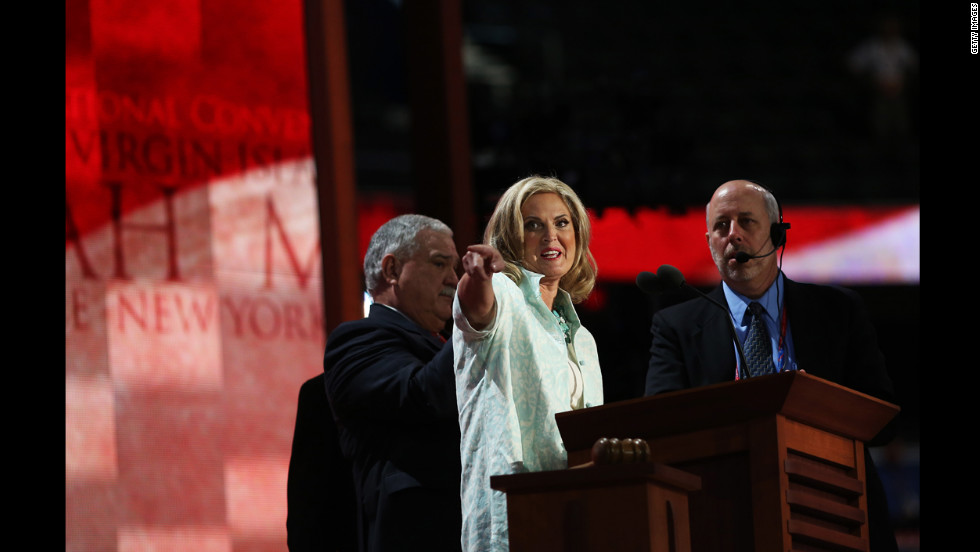 Ann Romney, Republican presidential candidate former Massachusetts Gov. Mitt Romney's wife, stands onstage with stage manager Howard Kolins during a soundcheck.
