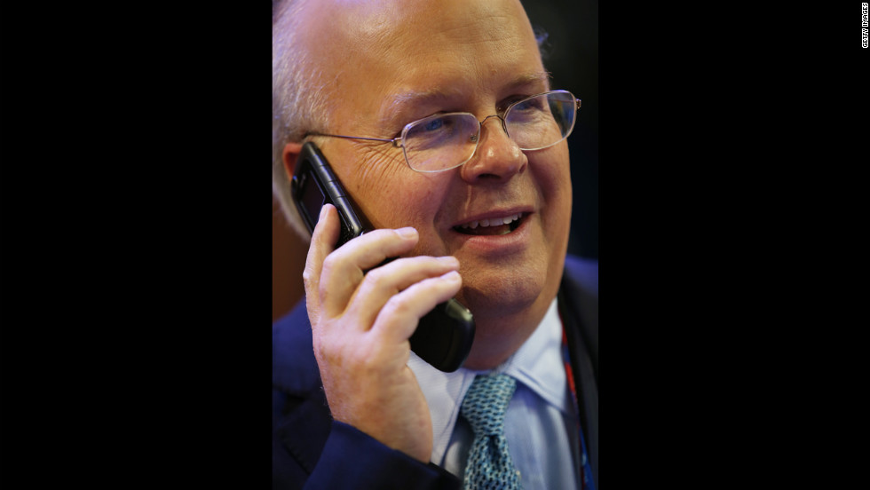 Karl Rove, former deputychief of staff and senior policy adviser to President George W. Bush, talks on a phone at the convention hall.