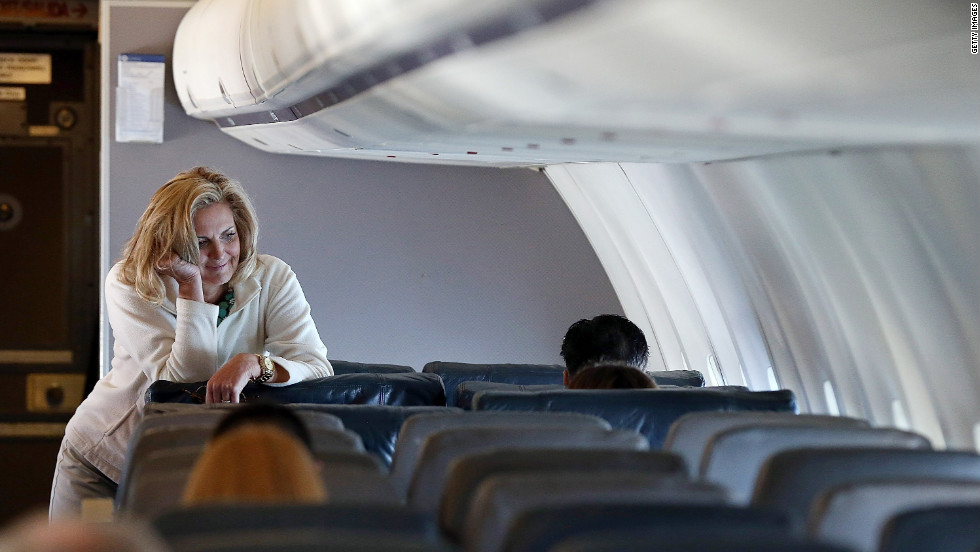 Ann Romney leans on a seat aboard the campaign plane en route to Tampa.