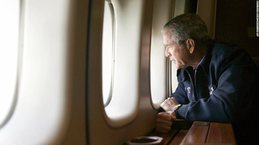 President George W. Bush looks out the window of Air Force One on August 31, 2005, as he flies over New Orleans. Returning to Washington from Texas, Air Force One descended to about 5,000 feet to allow Bush to view some of the worst damage from Hurricane Katrina.