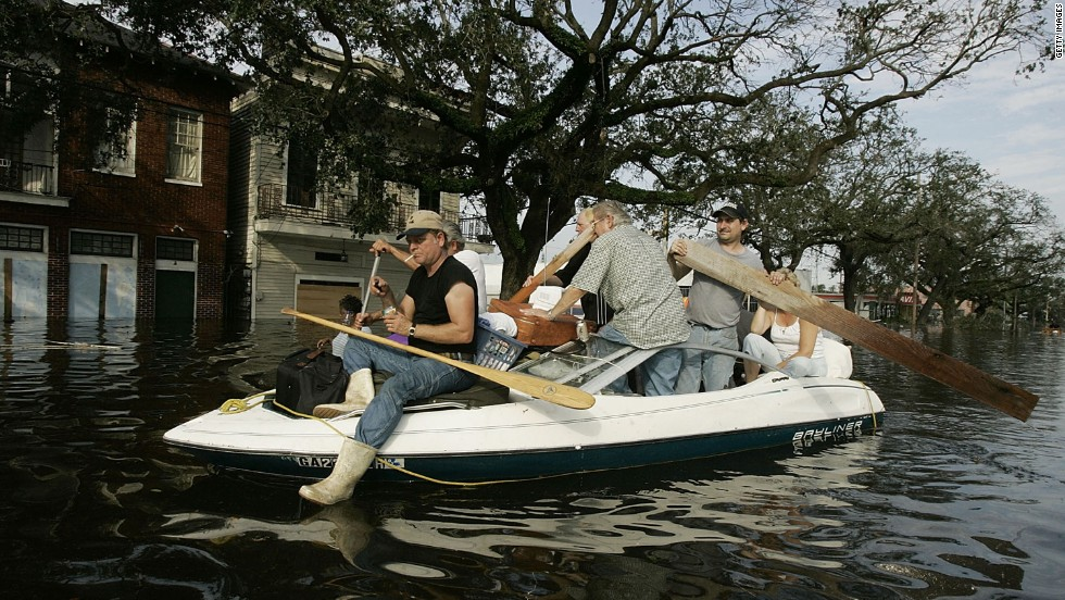 People try to get to higher ground as water rises on August 30, 2005, in New Orleans.