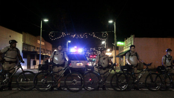 Police stand watch as protesters take to the streets for the anti-Romney protest march in Ybor City.