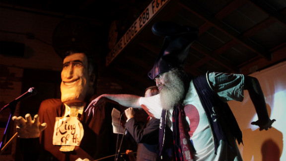 """""""Ritt Momney"""" engages in a mock political debate with Vermin Supreme, right, a performance artist and activist."""