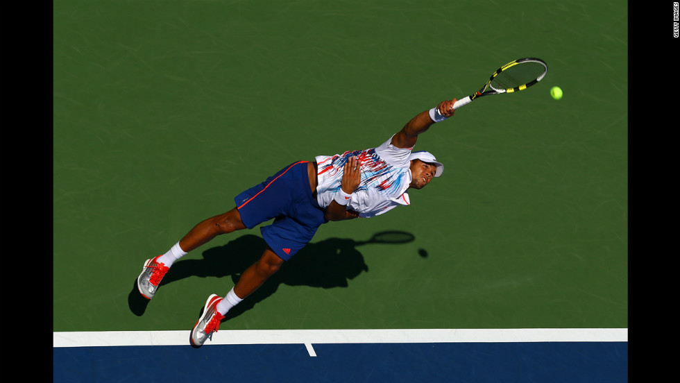 Jo-Wilfried Tsonga of France serves against Karol Beck of Slovakia during their first-round match on day two.