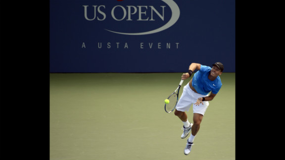 Tomas Berdych of the Czech Republic hits against David Goffin of Belguim during their men