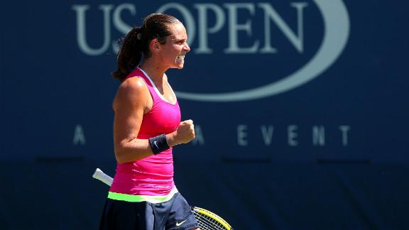 Roberta Vinci of Italy celebrates a shot against Urszula Radwanska of Poland.