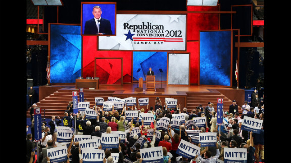 "People hold signs that say  ""Mitt!"" as U.S. Speaker of the House Rep. John Boehner, R-Ohio, speaks."