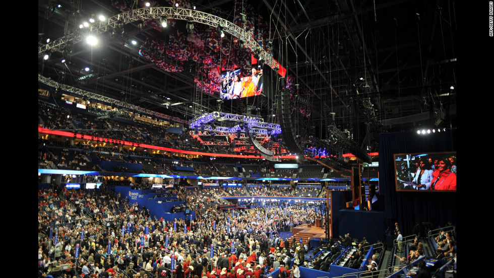 Delegates crowd the floor after the tallying of votes during the roll call for nomination of president of the United States at the Tampa Bay Times Forum.