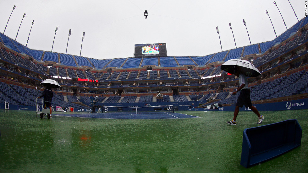 A downpour interrupts play Monday at Flushing Meadows.