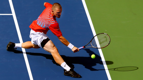 Russian Alex Bogomolov Jr. stretches to play a backhand against Andy Murray of Great Britain during their men