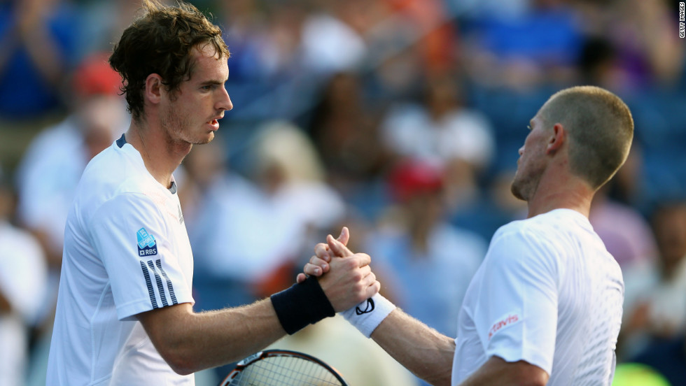 Andy Murray shakes hands at the net with Alex Bogomolov Jr. after winning his men's singles first-round match.