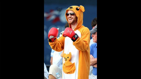A spectator in a kangeroo costume cheers from the stands during the match between Tatsuma Ito of Japan and Matthew Ebden of Australia.