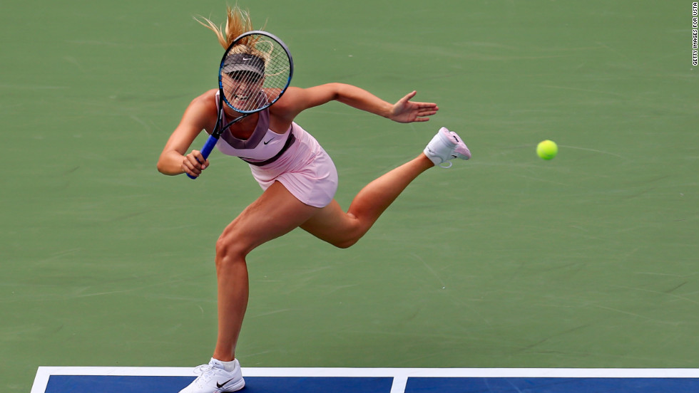 Maria Sharapova of Russia returns a shot to Melinda Czink of Hungary.