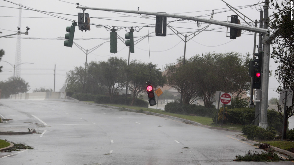 Isaac pounds Gulf CoastA traffic light dangles at an intersection in  Metairie, Louisiana, during