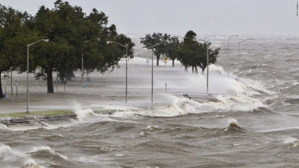 A storm surge causes water to quickly rise while waves pound the concrete seawall along the shores of Lake Pontchartrain in New Orleans on Tuesday, August 28.
