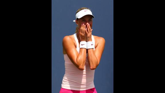 Andrea Hlavackova of the Czech Republic celebrates after defeating Klara Zakopalova, also of the Czech Republic, in the first round.