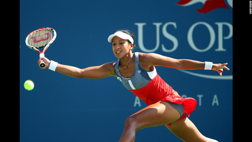 Anne Keothavong of Great Britain returns a shot during her first-round match against Angelique Kerber of Germany.