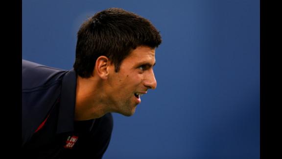 Serbian Novak Djokovic looks on against Italian Paolo Lorenzi during their men