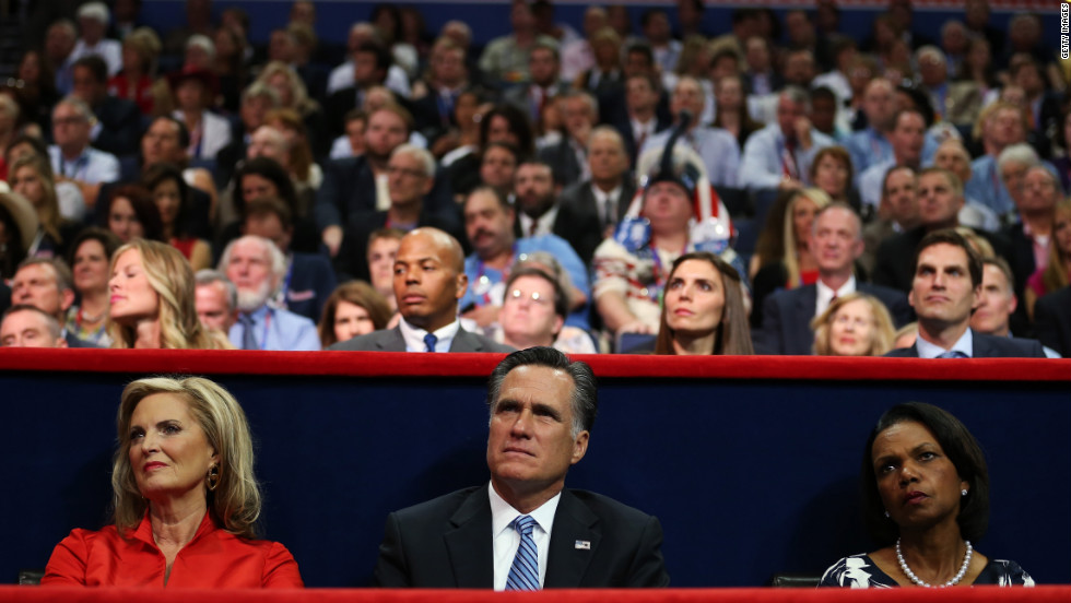 Republican presidential candidate Mitt Romney sits between his wife, Ann, and former U.S. Secretary of State Condoleezza Rice during Gov. Chris Christie's speech.