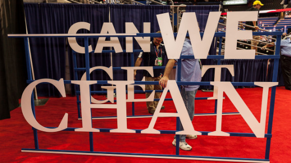 A worker changes the signs on the floor of the Republican National Convention on Wednesday.