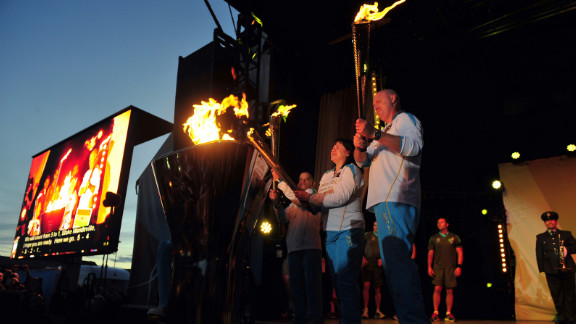 The cauldron is lit as the four Paralympic flames, which were lit on the UK