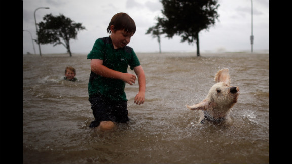 Joshua Keegan and his dog Scout swim in the rising water of Lake Pontchartrain.