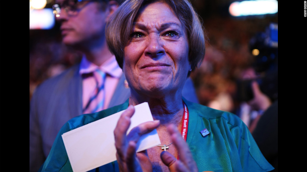 Delegate Crystal Berg of Hartford, Wisconsin, cries while watching the George H.W. Bush tribute Wednesday night.