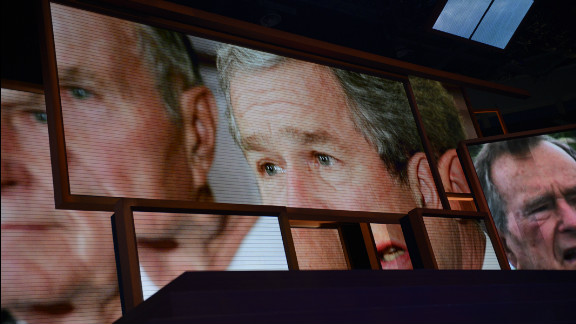 Former President George W. Bush is shown on the giant screens at the Tampa Bay Times Forum.
