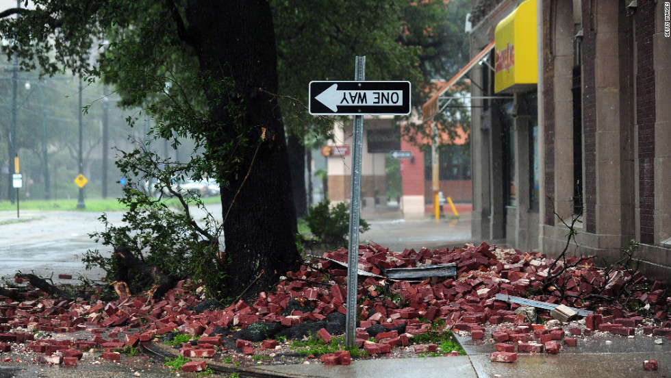 A street sign turned upside down, likely the result of bricks falling overnight from a building along the deserted streets of New Orleans.
