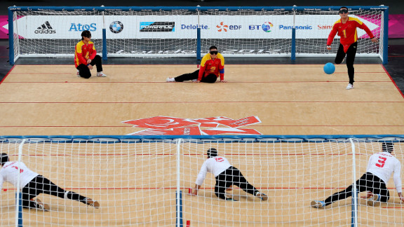 China, top, and Iran compete in the men