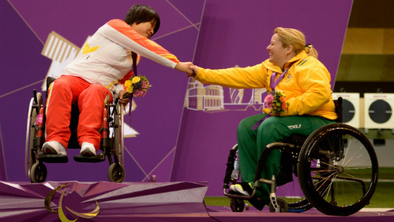 Cuiping Zhang, left, of China and Natalie Smith, right, of Australia shake hands on the podium after the women