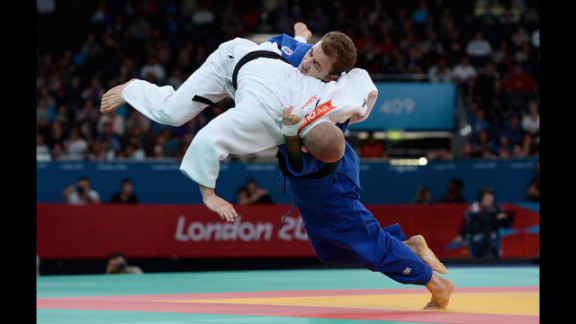 Ben Quilter, in white, of Great Britain competes against Mouloud Noura of Algeria during the men