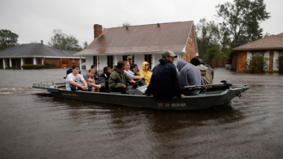 Residents are rescued Wednesday in Laplace, about 25 miles northwest of New Orleans, where the storm surge was unusually bad.