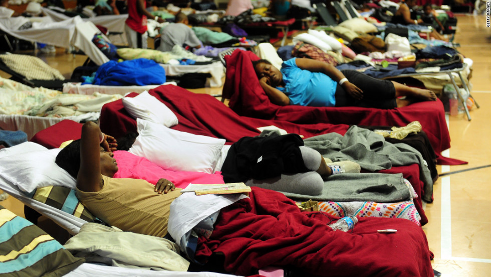 Storm-weary residents take refuge at a high school gymnasium in Belle Chasse, a low-lying area outside of New Orleans.