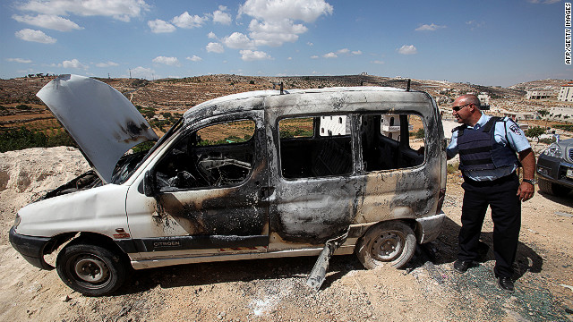 The August 16 firebombing of a taxi on the West Bank was followed 12 days later by  three more torched cars, including this one.