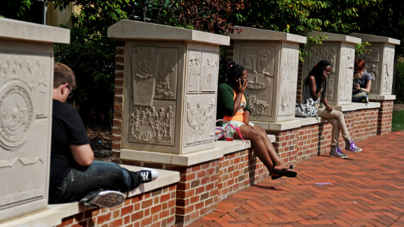 On the first day of classes, Penn State students talk on the phone and study outside the HUB, the student union center.