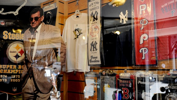 A Paterno cutout stands inside a storefront window on College Avenue.