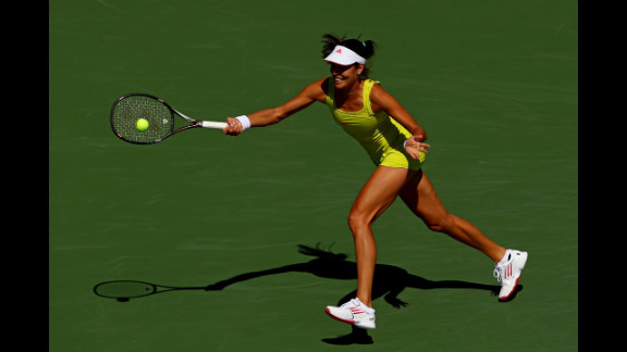 Ana Ivanovic of Serbia returns a shot against Sofia Arvidsson of Sweden during their women