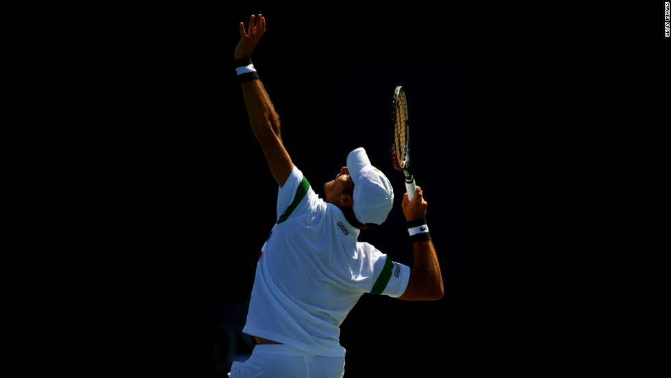 Pablo Andujar of Spain serves against Feliciano Lopez of Spain during their men's singles second-round match.