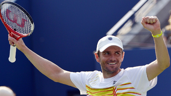 Mardy Fish of the United States celebrates after defeating Nikolay Davydenko of Russia.