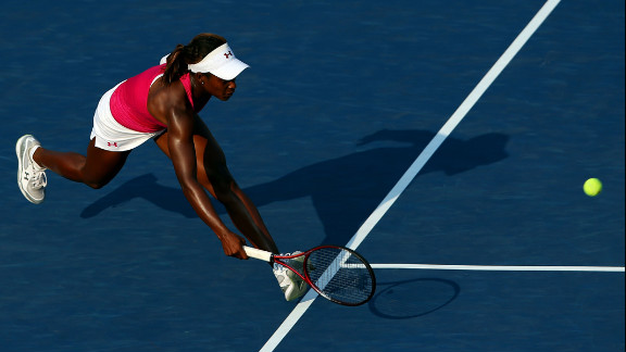 Sloane Stephens of the United States returns a shot during her women