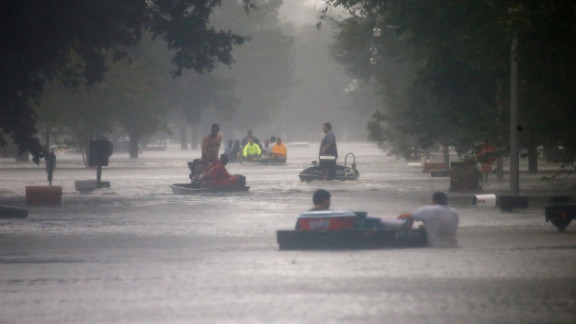 Rescue workers transport residents trapped by rising water from Isaac in Laplace, Louisiana, on Wednesday.