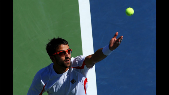 Serbian Janko Tipsarevic serves against Guillaume Rufin of France.